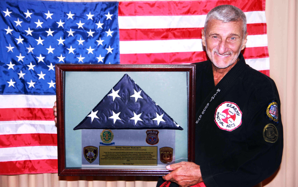 Grandmaster Marchetti with the Fort Lee post flag.
